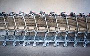 Shopping Cart Prints - A Row Of Grocery Carts Stacked Together Print by Marlene Ford