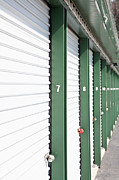 Mystery Tapestries Textiles Prints - A Row Of Locked Storage Units At A Self Storage Facility Print by Frederick Bass
