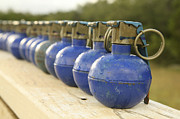 Ledge Photo Posters - A Row Of M-67 Training Grenades Poster by Stocktrek Images
