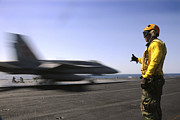 Uss Enterprise Prints - A Sailor Ensures An Fa-18c Hornet Print by Stocktrek Images