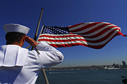 Uniforms Metal Prints - A Sailor Salutes The American Flag Metal Print by Stocktrek Images