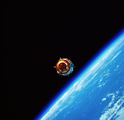 Engineering Framed Prints - A Satellite In Orbit Above Earth Framed Print by Stockbyte