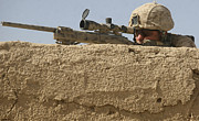 Ledge Photo Posters - A Scout Sniper Provides Security Poster by Stocktrek Images