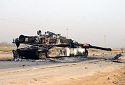 Second Gulf War Posters - A Scuttled Abrams Tank Rests In Front Poster by Everett