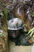 Trench Photos - A Seabee Low-crawls Through A Trench by Stocktrek Images