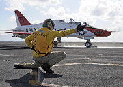 Kneeling Photo Prints - A Shooter Launches A T-45 Goshawk Print by Stocktrek Images
