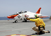 Naval Aircraft Prints - A Shooter Signlas The Launch Of A T-45a Print by Stocktrek Images