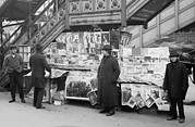 Group Portraits Framed Prints - A Sidewalk Newsstand In New York City Framed Print by Everett