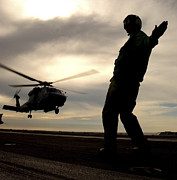 Motioning Posters - A Signalman Launches A Sh-60 Seahawk Poster by Stocktrek Images