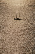 Cinque Terre Posters - A Silhouetted Sailboat On Sun Reflected Poster by Raul Touzon