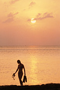 Cayman Islands Framed Prints - A Silhouetted Woman With Swim Flippers Framed Print by Michael S. Lewis