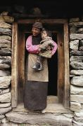 Laughing Posters - A Smiling Bhutanese Woman And Child Poster by Paul Chesley
