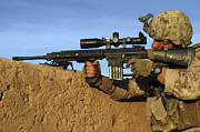 Ledge Photos - A Sniper Takes Aim At Insurgents by Stocktrek Images