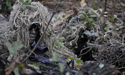 Ghillie Suits Prints - A Sniper Team Spotter And Shooter Print by Stocktrek Images
