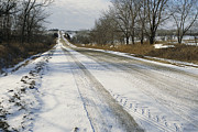 Winter Road Scenes Prints - A Snow-covered Road Passes Print by Joel Sartore