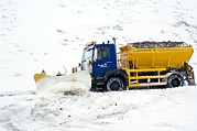Winter Roads Photo Prints - A Snow Plough Clearing A Road Print by Duncan Shaw