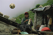 Ethnic And Tribal Peoples Posters - A Soccer Ball Flies Over The Head Poster by Randy Olson