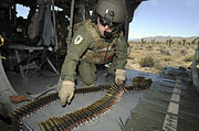 Machine Photos - A Soldier Checks The Ammo Belt by Stocktrek Images