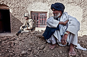 Sitting On Rock Prints - A Soldier Collects Information Print by Stocktrek Images