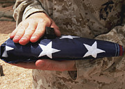 Patriotism Prints - A Soldier Holds The United States Flag Print by Stocktrek Images