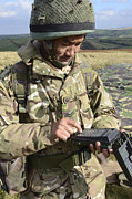 Electronics Photos - A Soldier Inputs The Firing Data by Andrew Chittock
