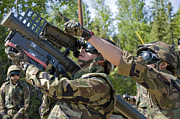 Shoulder-launched Prints - A Soldier Operates A Missile Launcher Print by Stocktrek Images