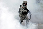 Conflict Framed Prints - A Soldier Races Through A Smoke Screen Framed Print by Stocktrek Images