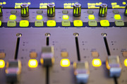 Recording Studio Posters - A Sound Board With Lighted Controls Poster by Roberto Westbrook