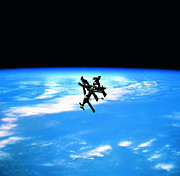 Progress Metal Prints - A Space Station In Orbit Above Earth Metal Print by Stockbyte