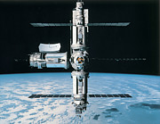 Space Exploration Photos - A Space Station In Orbit by Stockbyte