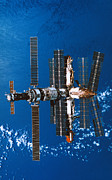 Planet Earth Posters - A Space Station Orbiting In Space Poster by Stockbyte