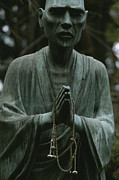 Buddhist Clergy Framed Prints - A Statue Of A Zen Buddhist Monk Holding Framed Print by Justin Guariglia