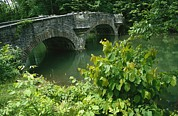 Cooperstown Photos - A Stone Bridge Crosses The Headwaters by Raymond Gehman