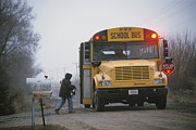 River Of Life Prints - A Student Boards A School Bus Print by Joel Sartore