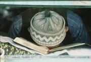 Humorous Photographs Prints - A Student Resting His Head On A Book Print by James L. Stanfield