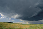 Custer State Park Prints - A Summer Storm Looms Over Prairie Print by Annie Griffiths