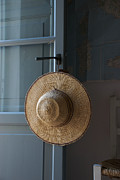 Sun Hat Prints - A Sun Hat Hangs On The Door Of A Tuscan Print by Heather Perry