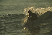 Silhouettes Metal Prints - A Surfer Rides A Gentle Swell Metal Print by Tim Laman