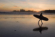 Beach Sunsets Prints - A Surfer Walks Across The Beach Print by Taylor S. Kennedy