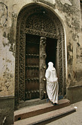 Ethnic Prints - A Swahili Woman Enters A Building Print by Michael S. Lewis