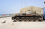 Muammar Gaddafi Prints - A T-55 Tank On The Seafront Print by Andrew Chittock