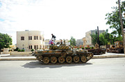 Syrian Prints - A T-72 Main Battle Tank On The Streets Print by Andrew Chittock