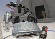 Improvised Explosive Device Framed Prints - A Talon 3b Robot Recovering A Stick Framed Print by Stocktrek Images