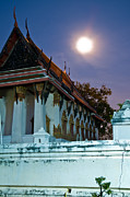 Blue Brick Prints - A tempel in a wat during a full moon night  Print by Ulrich Schade