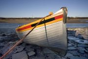 Row Boat Prints - A Tethered Row Boat Print by John Short