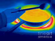 Wooden Spoons Framed Prints - A Thermogram Of Spoon And A Pan Of Food Framed Print by Ted Kinsman