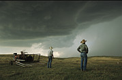 Farming Equipment Photos - A Thunderstorm Halts Haying As Two by Jim Richardson