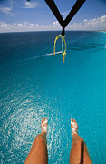 Elevated Views Framed Prints - A Tourist Goes Parasailing In Cancun Framed Print by Michael Melford