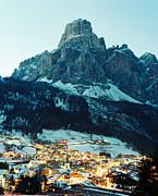 Road Travel Prints - A Town At Dusk By The Foot Of A Mountain Print by Joao Canziani