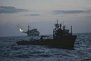 Etc. Photos - A Trawler Passes Near An Oil Rig by Bill Curtsinger